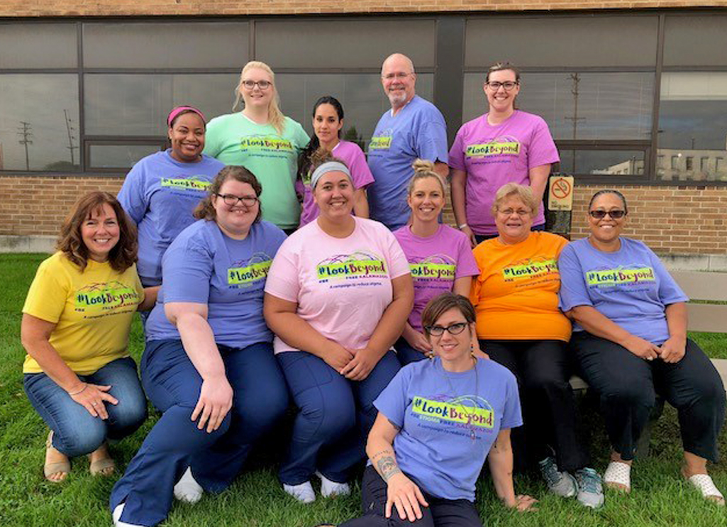 A Group photo of nursing students from Kalamazoo Valley Community College, after taking the Adult Mental Health First training. Everyone in the photo is wearing Look Beyond t-shirts.